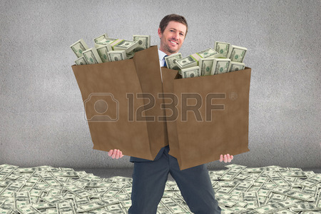 39728600-businessman-carrying-bag-of-dollars-against-grey-room