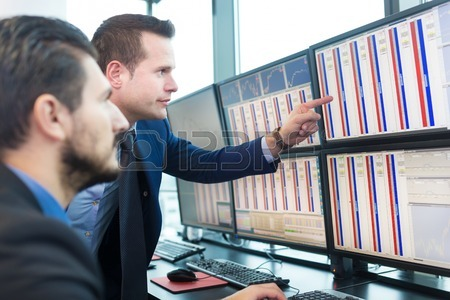 45104968-businessmen-trading-stocks-stock-traders-looking-at-graphs-indexes-and-numbers-on-multiple-computer